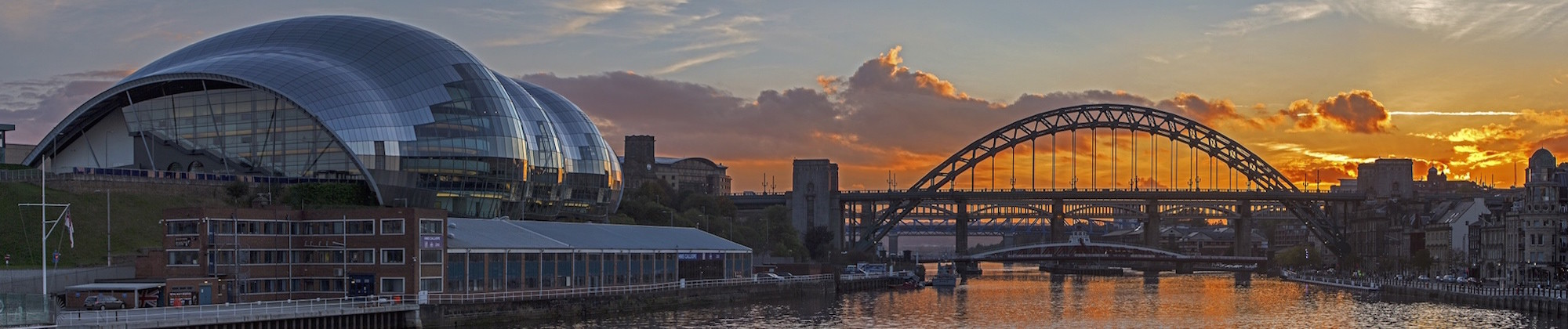 Sun setting behind the Tyne Bridge Newcastle upon Tyne